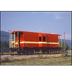 Caboose on the side of the road.