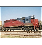 An SD45 shell turned SD40-3 basks in the AM sun.