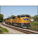 Western power motivates CSX Q676 mixed freight through May-retta.