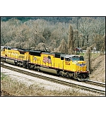 GM paces GM. A General Motors EMD product (well, it WAS GM when the loco was built) runs side by side with another GM product on US 41.