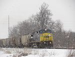 CSX 7365 leads a CP 300 series train east towards Milwaukee in lake effect snow at Duplainville, WI. February 26th, 2011