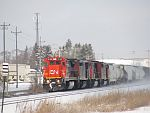 CN C40-8 (EX-CNW) 2108 leads a manifest south at the north end of Duplainville, WI. February 27th, 2011