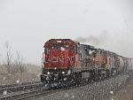 An ex-CNW C40-8 leads a northbound as lake effect snow shows up at Duplainville. March 26th, 2011