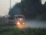 EMDs bring the Ford train east through the morning fog at Duplainville. August 4th, 2011