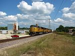A UP westbound rolls under power lines, past vacant industry, and my friend's truck. August 16th, 2011
