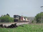 NS power creeps a manifest north on CN's Duplainville siding. May 19th, 2011