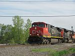 A CN northbound crosses Green Rd. after crossing the Duplainville diamond. May 20th, 2011