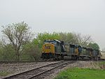 An all CSX grain train rolls west in the rain on the CP at Duplainville. May 21st, 2011