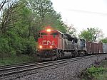 A northbound led by CN 8000 creeps up the siding at Duplainville. May 23rd, 2011