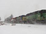 A going away shot of the same train. Showcasing the rainbow of units. Duplainville, WI. February 26th, 2011