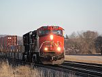 A CN southbound stack train rolls through farmland at Duplainville. March 26th, 2011