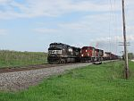 A widecab SD40-2 overtakes the waiting NS on the siding. May 19th, 2011