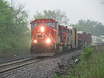 A CN northbound pushes on through heavy rain at Duplainville. May 21st, 2011
