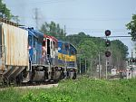 A grain train gets the light to crossover to main 1 as it approaches the Duplainville diamond. June 26th, 2011